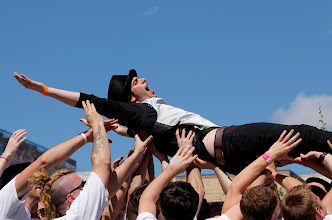 Photo: George Jacobellis of Austin, Texas, enjoys crowd surfing at a Skype event at the South by Southwest festival this week in Austin. Photo by Garrett Hubbard, USA TODAY.