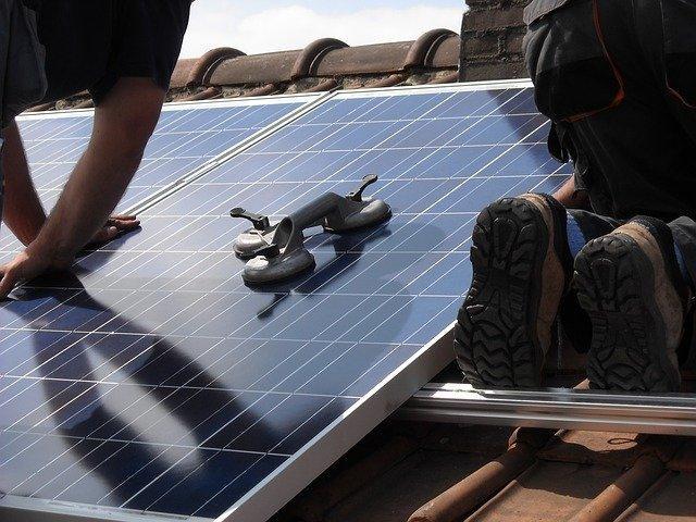PosiGen CEO installing solar panels
