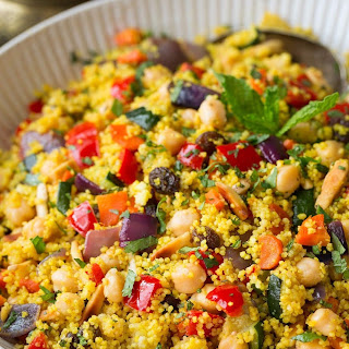 Moroccan Couscous with Roasted Vegetables, Chick Peas and Almonds.