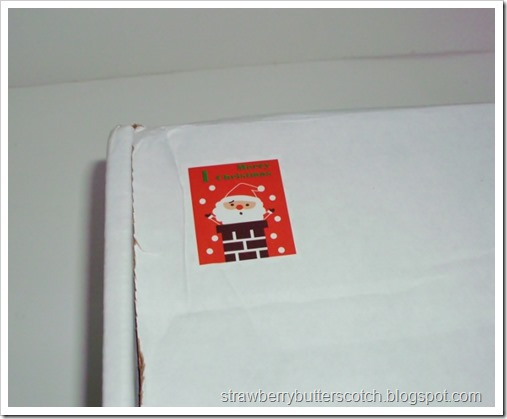 Close up of a cute Christmas sticker on a subscription box.