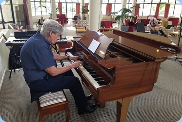 Ian Jackosn playing the Steinway grand piano.