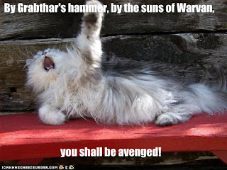 Lolcat raising a paw saying By Grabthar's Hammer