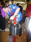 "John Key, Prime Minister of New Zealand using the Aquarius coconut oil press while visiting Apia, Samoa in 2009. While using the press he said    ""This is easier than being Prime Minister"". www.aquariusnz.co.nz"