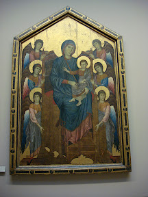 Maestà by Cimabue - Giotto's teacher and the first great artist of the Italian Renaissance.  This was painted in 1270 AD!