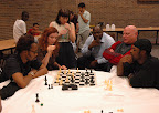 The RZA of the Wu-Tang Clan and Jennifer play team chess against Michael Shahade and Rugged Monk, while 9queens co-founder Jean Hoffman looks on.