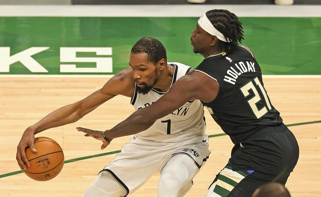 Kevin Durant #7 of the Brooklyn Nets moves against Jrue Holiday #21 of the Milwaukee Bucks at Fiserv Forum on June 17, 2021 in Milwaukee, Wisconsin. (Photo by Jonathan Daniel/Getty Images)