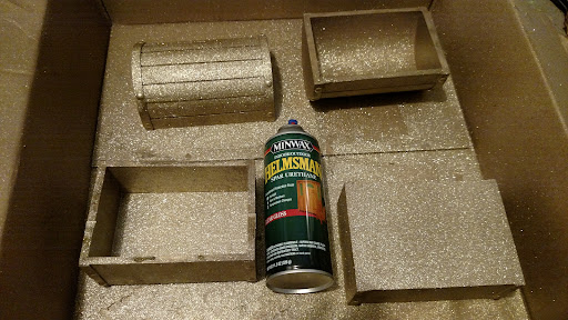 This next step is necessary to because, without the polyurethane, the glitter flakes off and gets everywhere! Spray the box with Polyurethane, inside and out. Leave it to dry for 24 hours. (Make sure you're wearing protective rubber or latex gloves.)