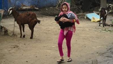 Girl bringing sister to be vaccinated