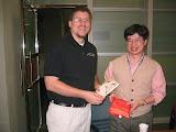 Arthur giving Scott gifts for teaching English at Nanya