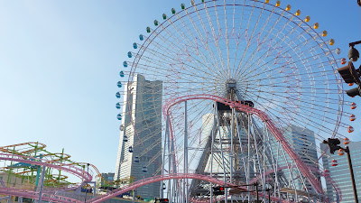 Cosmo Clock 21 (at one point the tallest ferris wheel in the world and world's largest clock with a height of 112.5 m / 369 ft and diameter of 100 m / 330 ft and 60 cars each carrying 8 people) in Yokohama