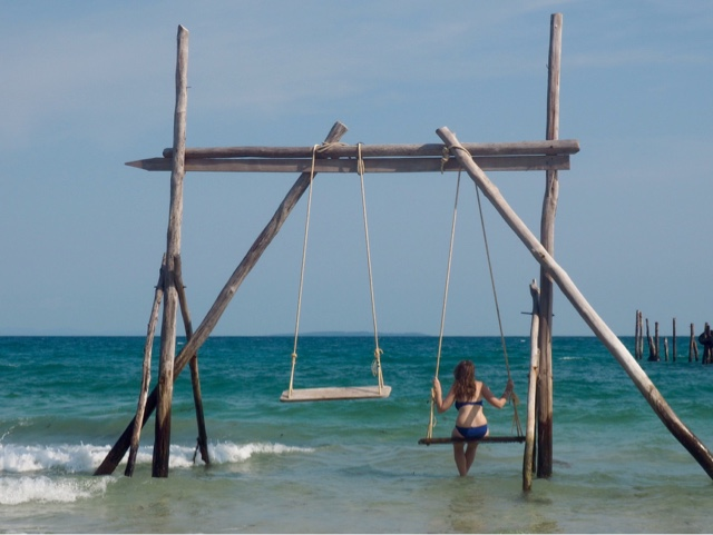 Girl on a swing in the ocean at Nature Beach, Koh Rong, Cambodia