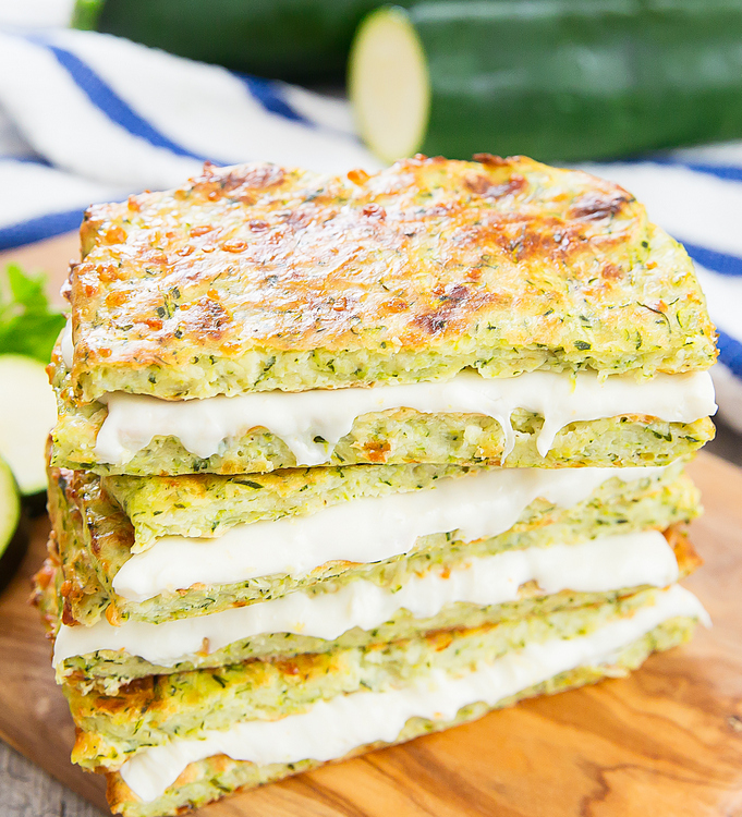 three zucchini crusted grilled cheese sandwiches stacked on top of each other
