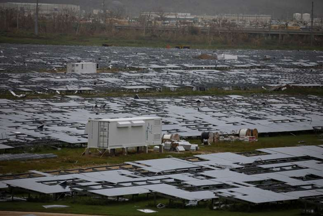 Damaged solar panels are seen after the area was hit by Hurricane Maria in Humacao, Puerto Rico on 22 September 2017. Photo: Carlos Garcia Rawlins / Reuters