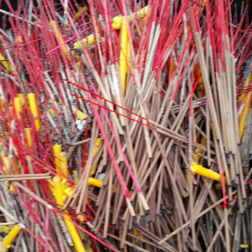Thailand close up - used incense and candles at the Erawan Shrine
