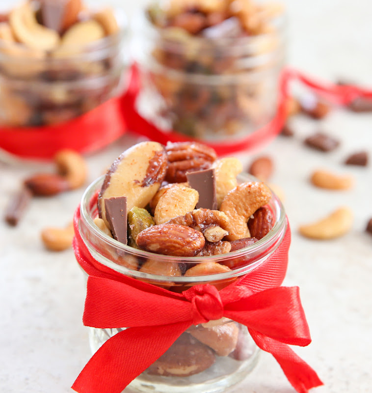 photo of Holiday Spiced Mixed Nuts in a jar tied with a red ribbon