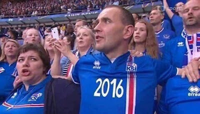 Iceland president sitting among fans at the euro 2016
