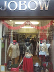 shop frontage and golden coloured clothes display