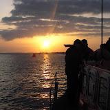 Crew members enjoying the setting sun on Poole's Tyne class lifeboat 'City of Sheffield'
