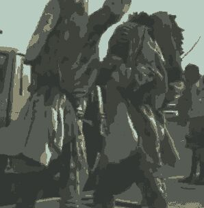 Photos: Two Masquerades Spotted Exchanging Blows In Lagos