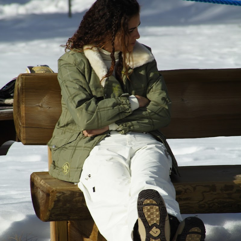 Meribel_65 Girl on Bench.jpg