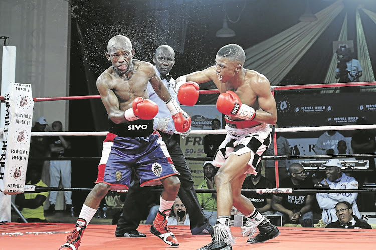 Sivenathi Nontshinga connects with a right hook en route to his ninth-round TKO win over Siyabonga Siyo at the Orient Theatre. Nontshinga will now face Christaian Araneta next month in Port Elizabeth.