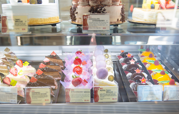 photo of slices of cake in a display case
