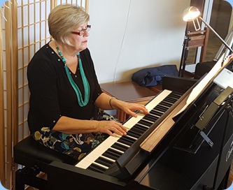 Kay Boyes playing the Village's Yamaha Clavinova CVP-709
