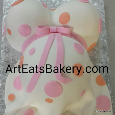 Baby bump custom modern baby shower cake with peach and pink polkadot fondant dress design