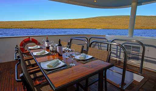 Dine on Ecuadorian and international dishes in an al fresco setting during your voyage on Treasure of Galapagos.