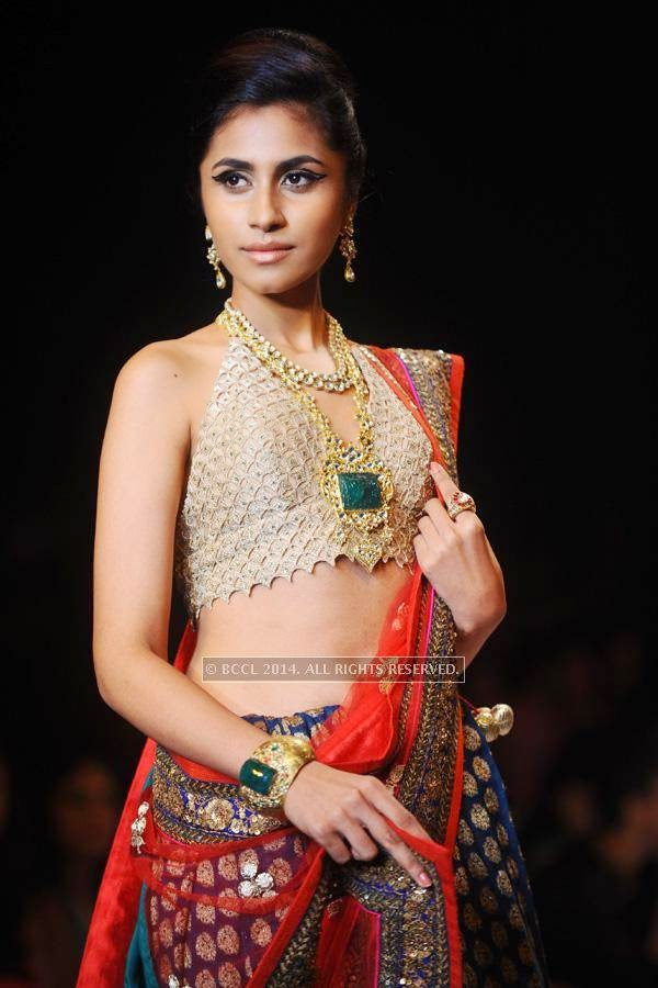 A model walks the ramp for Saboo Fine Jewels on Day 3 of India International Jewellery Week (IIJW), 2014, held at Grand Hyatt, in Mumbai.