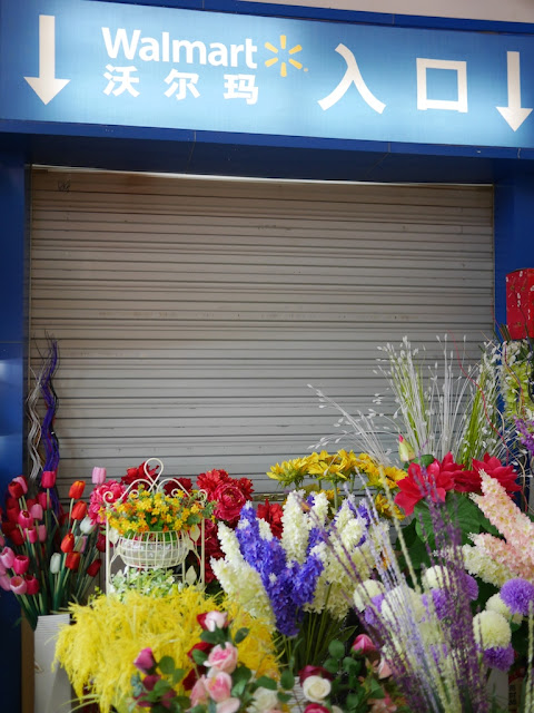 flowers for sale in front of a closed entrance for a Walmart