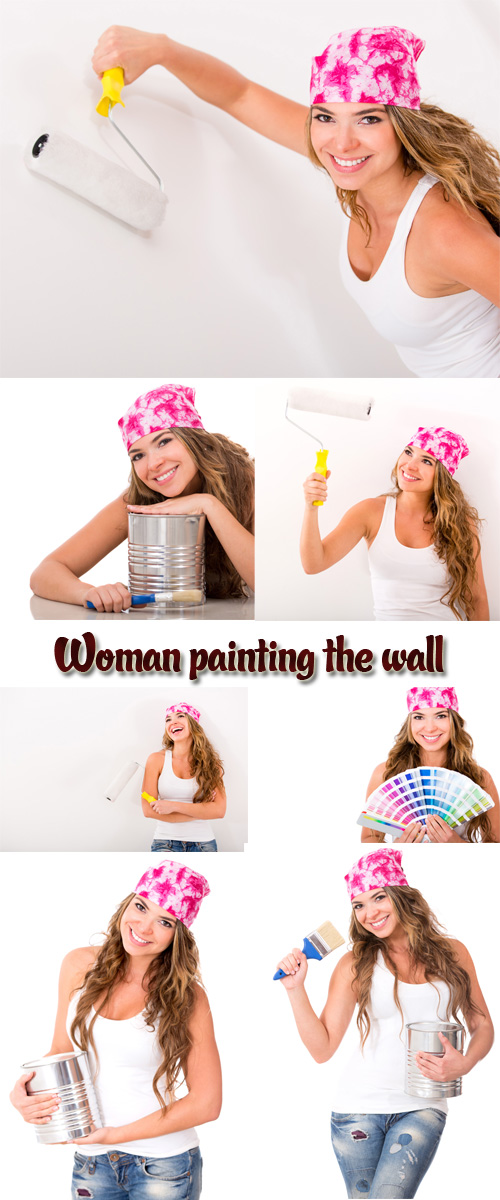 Stock Photo: Woman painting the wall