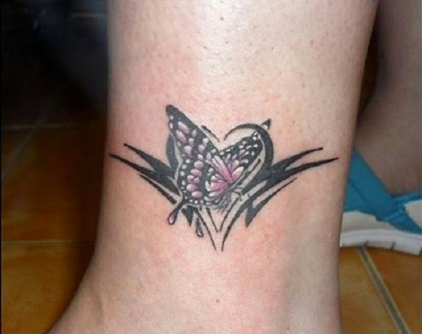 small tattoo butterfly design on leg