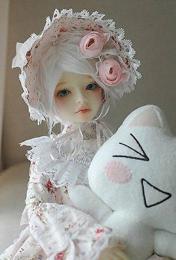 Imagen fondo muñeca vintage flores rosas rosas gatito blanco