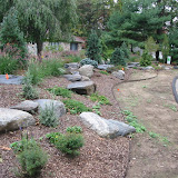 Informal rock and perennial planting area