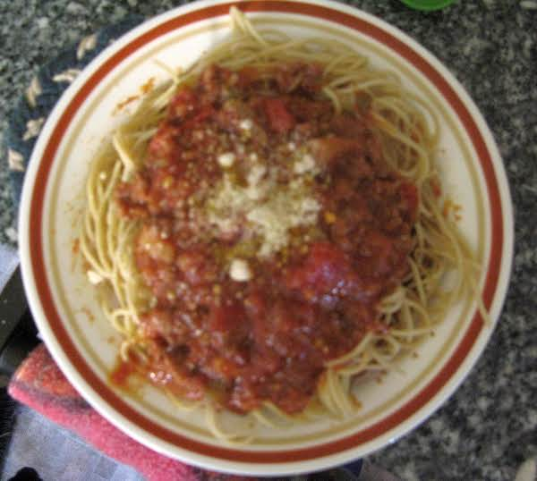Gramma Cathys Original Spaghetti Sauce, On Top Pasta & Topped With Grated Romano Cheese