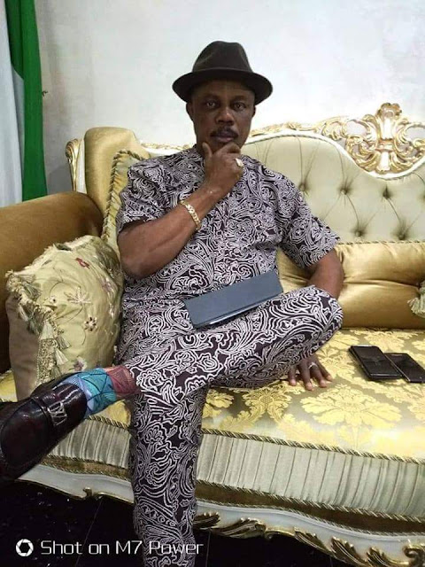 Caption the photograph of governor obiano pose