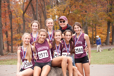 Team champions Ridgewood after the race Front  18th place from left #2568 Kelly Cleary , 3rd place  #2571  , 21 #2572 Leah  Rosenfeld, ,24 #2567,12th place #2569 Emily Fishbein, Rear  25th place #2573 Laura  Weisberger and 20 #2570 Jones, Lesley with coach Jock Brown.