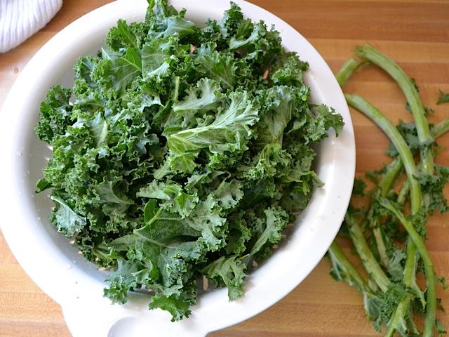 fresh kale in colander to rinse