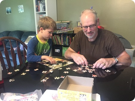 Nolan and Grandpa doing a puzzle