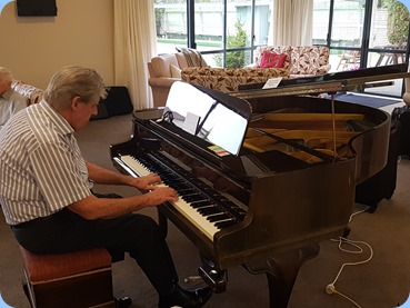 Ian Jackson playing the Schimmel grand piano
