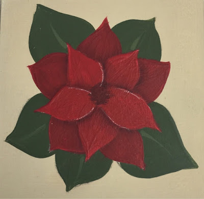 A folk art poinsettia ready for the final details