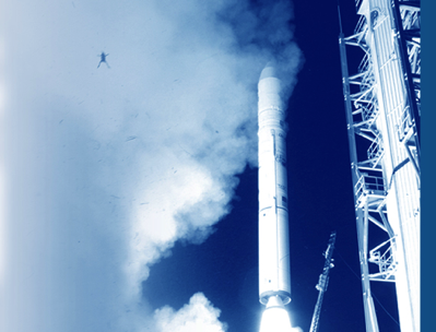 A frog jumps high as a rocket launches behind it