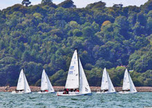 J/70s sailing upwind off Plymouth, England- J/Cup regatta