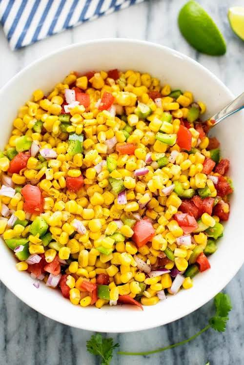 "Summer Corn Salad""Among the corn are bell peppers, tomato, red onion and..."