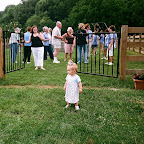 Whitney Leigh Philpott escapes the fence as mother looks on.