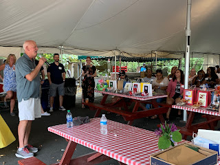 Rick High, the President of Development, giving the opening speech to all of the employees under the tent at Kimball Farm