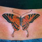 Orange butterfly lower back - tattoos ideas