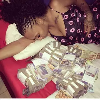 SHOCKING!! Slay Queen Used By Yahoo Boys For Ritual Vomits Money In Public [Photos]