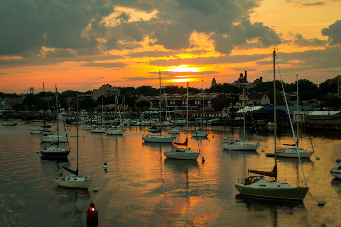 Sailboats at sunset at a harbor in Brooklyn New York